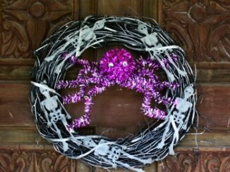 Halloween Wreath With Glow In The Dark Skeletons image