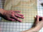 Pin sewing pattern to cutting board image