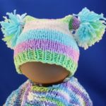 baby hat with pom poms image
